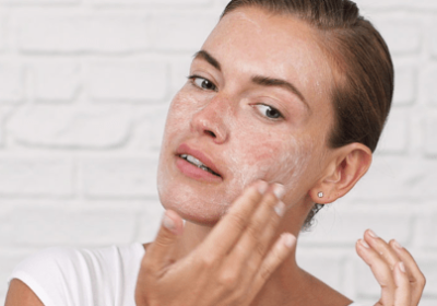 Woman Using Makeup Remover And Cleanser