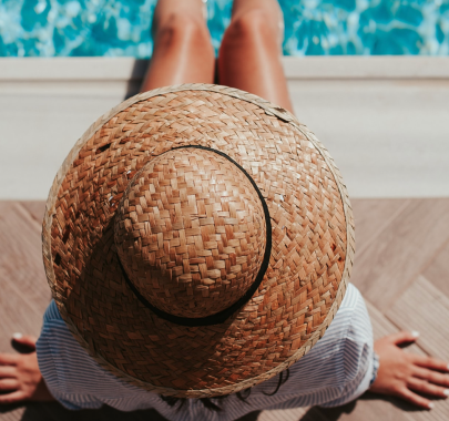 After Sun Skincare - Image Of Woman In A Sunhat