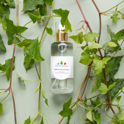 Three Gems Witch Hazel Toner Nestled In Green Leaves